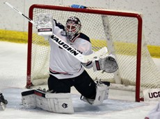 UConn's Rob Nichols (31) makes a blocker save during the UConn Huskies vs Queen's University Gaels men's hockey game at Freitas Ice Forum in Storrs, CT on October 3, 2015.