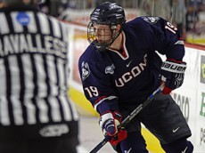 UConn's Evan Richardson (19) during the UConn Huskies vs Mass Minutemen men's college hockey game at the Mullins Center in Amherst, MA on November 7, 2015.