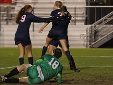 UConn's Tanya Altrui (29) celebrates with Rachel Hill (3) and Stephanie Ribeiro (18) after Hill's goal during the UConn Huskies vs Notre Dame Fighting Irish NCAA Women's Soccer Tournament Second Round game at Yurcak Field in Piscataway, NJ on November 20, 2015.