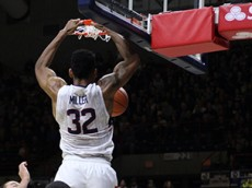 UConn's Shonn Miller (32) finishes off the dunk during the UConn Huskies vs Furman Paladins men's college basketball game at Gampel Pavilion on November 21, 2015.