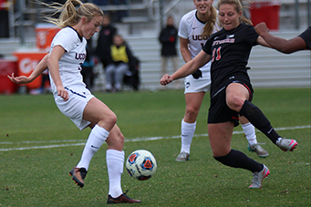 UConn's Rachel Hill (3) gets a shot off in front of Rutgers' Hayley Katkowski (11) during the UConn Huskies vs Rutgers Scarlet Knights NCAA Women's Soccer Tournament Third Round game at Yurcak Field in Piscataway, NJ on November 22, 2015.