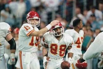 Kansas City Chiefs? quarterback Joe Montana congratulates Chiefs? J. J. Birden after a 11-yard touchdown pass in the fourth quarter Sunday, Jan. 16, 1994 in Houston. The Chiefs beat the Houston Oilers 28-20. (AP Photo/Lynne Sladky)