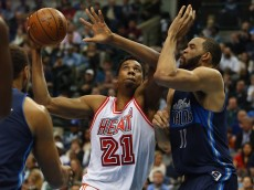 DALLAS, TX - FEBRUARY 03:  Hassan Whiteside #21 of the Miami Heat takes a shot against JaVale McGee #11 of the Dallas Mavericks in the first half at American Airlines Center on February 3, 2016 in Dallas, Texas.  NOTE TO USER: User expressly acknowledges and agrees that, by downloading and or using this photograph, User is consenting to the terms and conditions of the Getty Images License Agreement.  (Photo by Ronald Martinez/Getty Images)