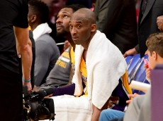 LOS ANGELES, CA - APRIL 13:  Kobe Bryant #24 of the Los Angeles Lakers looks on from the bench late in the fourth quarter against the Utah Jazz at Staples Center on April 13, 2016 in Los Angeles, California. NOTE TO USER: User expressly acknowledges and agrees that, by downloading and or using this photograph, User is consenting to the terms and conditions of the Getty Images License Agreement.  (Photo by Harry How/Getty Images)