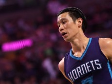 BOSTON, MASSACHUSETTS - APRIL 11: Jeremy Lin #7 of the Charlotte Hornets looks on in the first half against the Boston Celtics at TD Garden on April 11, 2016 in Boston, Massachusetts. NOTE TO USER: User expressly acknowledges and agrees that, by downloading and/or using this photograph, user is consenting to the terms and conditions of the Getty Images License Agreement.  (Photo by Mike Lawrie/Getty Images)
