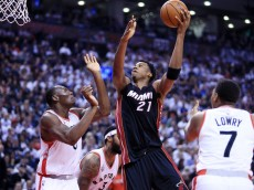 TORONTO, ON - MAY 05:  Hassan Whiteside #21 of the Miami Heat shoots the ball as Bismack Biyombo #8 of the Toronto Raptors defends in the second half of Game Two of the Eastern Conference Semifinals during the 2016 NBA Playoffs at the Air Canada Centre on May 5, 2016 in Toronto, Ontario, Canada.  NOTE TO USER: User expressly acknowledges and agrees that, by downloading and or using this photograph, User is consenting to the terms and conditions of the Getty Images License Agreement.  (Photo by Vaughn Ridley/Getty Images)