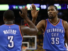 OAKLAND, CA - MAY 30:  Kevin Durant #35 of the Oklahoma City Thunder high-fives Dion Waiters #3 in Game Seven of the Western Conference Finals against the Golden State Warriors during the 2016 NBA Playoffs at ORACLE Arena on May 30, 2016 in Oakland, California. NOTE TO USER: User expressly acknowledges and agrees that, by downloading and or using this photograph, User is consenting to the terms and conditions of the Getty Images License Agreement.  (Photo by Ezra Shaw/Getty Images)