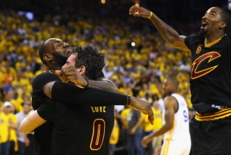 OAKLAND, CA - JUNE 19:  LeBron James #23, Kevin Love #0, and J.R. Smith #5 of the Cleveland Cavaliers celebrate after defeating the Golden State Warriors 93-89 in Game 7 of the 2016 NBA Finals at ORACLE Arena on June 19, 2016 in Oakland, California. NOTE TO USER: User expressly acknowledges and agrees that, by downloading and or using this photograph, User is consenting to the terms and conditions of the Getty Images License Agreement.  (Photo by Ezra Shaw/Getty Images)