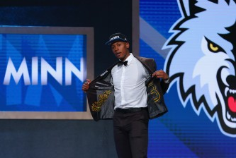 NEW YORK, NY - JUNE 23:  Kris Dunn walks on stage after being drafted fifth overall by the Minnesota Timberwolves in the first round of the 2016 NBA Draft at the Barclays Center on June 23, 2016 in the Brooklyn borough of New York City. NOTE TO USER: User expressly acknowledges and agrees that, by downloading and or using this photograph, User is consenting to the terms and conditions of the Getty Images License Agreement.  (Photo by Mike Stobe/Getty Images)