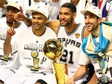 SAN ANTONIO, TX - JUNE 15:  The San Antonio Spurs celebrate with the Larry O'Brien trophy after defeating the Miami Heat to win the 2014 NBA Finals at the AT&T Center on June 15, 2014 in San Antonio, Texas. NOTE TO USER: User expressly acknowledges and agrees that, by downloading and or using this photograph, User is consenting to the terms and conditions of the Getty Images License Agreement.  (Photo by Andy Lyons/Getty Images)