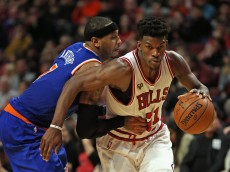 CHICAGO, IL - JANUARY 01:  Jimmy Butler #21 of the Chicago Bulls drives past Carmelo Anthony #7 of the New York Knicks at the United Center on January 1, 2016 in Chicago, Illinois. The Bulls defeated the Knicks 108-81. NOTE TO USER: User expressly acknowledges and agrees that, by downloading and or using the photograph, User is consenting to the terms and conditions of the Getty Images License Agreement.  (Photo by Jonathan Daniel/Getty Images)
