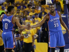 OAKLAND, CA - MAY 26:  Russell Westbrook #0 and Kevin Durant #35 of the Oklahoma City Thunder celebrate after a play against the Golden State Warriors during Game Five of the Western Conference Finals during the 2016 NBA Playoffs at ORACLE Arena on May 26, 2016 in Oakland, California.  (Photo by Ezra Shaw/Getty Images)