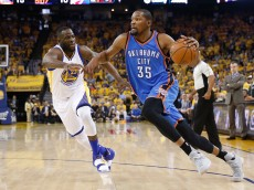 OAKLAND, CA - MAY 26:  Kevin Durant #35 of the Oklahoma City Thunder drives with the ball against Draymond Green #23 of the Golden State Warriors during Game Five of the Western Conference Finals during the 2016 NBA Playoffs at ORACLE Arena on May 26, 2016 in Oakland, California.  (Photo by Ezra Shaw/Getty Images)