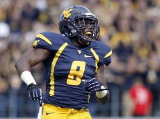 MORGANTOWN, WV - SEPTEMBER 29:  Karl Joseph #8 of the West Virginia Mountaineers pumps up the crowd against the Baylor Bears during the game on September 29, 2012 at Mountaineer Field in Morgantown, West Virginia.  (Photo by Justin K. Aller/Getty Images)