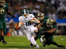 ARLINGTON, TX - JANUARY 01:  Connor Cook #18 of the Michigan State Spartans is taken to the ground by Shawn Oakman #2 of the Baylor Bears and Andrew Billings #75 of the Baylor Bears during the second half of the Goodyear Cotton Bowl Classic at AT&T Stadium on January 1, 2015 in Arlington, Texas.  (Photo by Tom Pennington/Getty Images)