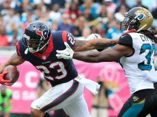 JACKSONVILLE, FL - OCTOBER 18:  Johnathan Cyprien #37 of the Jacksonville Jaguars attempts to tackle  Arian Foster #23 of the Houston Texans during the game at EverBank Field on October 18, 2015 in Jacksonville, Florida.  (Photo by Sam Greenwood/Getty Images)