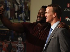 ENGLEWOOD, CO - MARCH 07:  Quarterback Peyton Manning poses for a photograph with former teammate Kenny Anunike after announcing his retirement from the NFL at the UCHealth Training Center on March 7, 2016 in Englewood, Colorado. Manning, who played for both the Indianapolis Colts and Denver Broncos in a career which spanned 18 years, is the NFL's all-time leader in passing touchdowns (539), passing yards (71,940) and tied for regular season QB wins (186). Manning played his final game last month as the winning quarterback in Super Bowl 50 in which the Broncos defeated the Carolina Panthers, earning Manning his second Super Bowl title.  (Photo by Doug Pensinger/Getty Images)