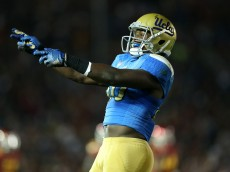 PASADENA, CA - NOVEMBER 22:   Linebacker Myles Jack #30 of the UCLA Bruins celebrates after the Bruins stopped the USC Trojans on fourth down on the five yard line to take over on downs on the final play of the first quarter at the Rose Bowl on November 22, 2014 in Pasadena, California.  (Photo by Stephen Dunn/Getty Images)