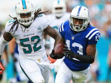 MIAMI GARDENS, FL - DECEMBER 27: T.Y. Hilton #13 of the Indianapolis Colts is chased by Kelvin Sheppard #52 of the Miami Dolphins during the second quarter of the game at Sun Life Stadium on December 27, 2015 in Miami Gardens, Florida.  (Photo by Rob Foldy/Getty Images)
