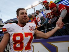 BALTIMORE, MD - DECEMBER 20:  Tight end Travis Kelce #87 of the Kansas City Chiefs  celebrates with fan while running off the field following the Chiefs 34-14 win over the Baltimore Ravens at M&T Bank Stadium on December 20, 2015 in Baltimore, Maryland.  (Photo by Rob Carr/Getty Images)