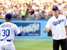 LOS ANGELES, CA - JUNE 06:  Jared Goff #16 of the Los Angeles Rams tosses a football to manager Dave Roberts #30 prior to throwing out a ceremonial first pitch before the game against the Colorado Rockies at Dodger Stadium on June 6, 2016 in Los Angeles, California.  (Photo by Harry How/Getty Images)