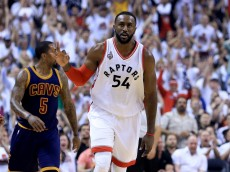 TORONTO, ON - MAY 23: Patrick Patterson #54 of the Toronto Raptors reacts after a three point basket in the first quarter against the Cleveland Cavaliers in game four of the Eastern Conference Finals during the 2016 NBA Playoffs at the Air Canada Centre on May 23, 2016 in Toronto, Ontario, Canada. NOTE TO USER: User expressly acknowledges and agrees that, by downloading and or using this photograph, User is consenting to the terms and conditions of the Getty Images License Agreement.  (Photo by Vaughn Ridley/Getty Images)