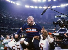 NEW ORLEANS - JANUARY 26:  Defensive coordinator Buddy Ryan of the Chicago Bears gets carried off the field by defensive lineman Richard Dent #95 and teammate as they celebrate their victory over the New England Patriots in Super bowl XX at Louisiana Superdome on January 26, 1996 in New Orleans, Louisiana.  The Bears won 46-10.  (Photy by Mike Powell/Getty Images)