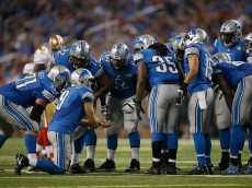 DETROIT, MI - DECEMBER 27: Matthew Stafford #9 of the Detroit Lions calls a play to his team in a huddle while playing the San Francisco 49ers in the first half at Ford Field on December 27, 2015 in Detroit, Michigan. (Photo by Gregory Shamus/Getty Images)
