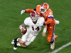 GLENDALE, AZ - JANUARY 11:  Shaq Lawson #90 of the Clemson Tigers sacks Jake Coker #14 of the Alabama Crimson Tide in the second quarter during the 2016 College Football Playoff National Championship Game at University of Phoenix Stadium on January 11, 2016 in Glendale, Arizona.  (Photo by Norm Hall/Getty Images)