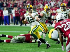 GLENDALE, AZ - JANUARY 16: Quarterback Aaron Rodgers #12 of the Green Bay Packers looks to pass during the first half of the NFC Divisional Playoff Game against the Arizona Cardinals at University of Phoenix Stadium on January 16, 2016 in Glendale, Arizona.  (Photo by Harry How/Getty Images)