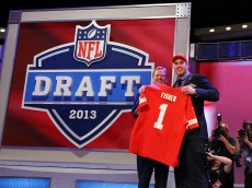 NEW YORK, NY - APRIL 25:  Eric Fisher (R) of Central Michigan Chippewas stands on stage with NFL COmmissioner Roger Goodell after Fisher was picked #1 overall by the Kansas City Chiefs in the first round of the 2013 NFL Draft at Radio City Music Hall on April 25, 2013 in New York City.  (Photo by Al Bello/Getty Images)