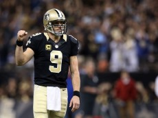 NEW ORLEANS, LA - NOVEMBER 01:  Drew Brees #9 of the New Orleans Saints reacts to a touchdown during the third quarter of a game against the New York Giants at the Mercedes-Benz Superdome on November 1, 2015 in New Orleans, Louisiana.  (Photo by Sean Gardner/Getty Images)