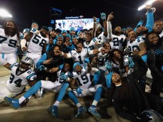 CHARLOTTE, NC - JANUARY 24:  Cam Newton #1 of the Carolina Panthers celebrates with teammates on the sideline in the fourth quarter against the Arizona Cardinals during the NFC Championship Game at Bank of America Stadium on January 24, 2016 in Charlotte, North Carolina.  (Photo by Streeter Lecka/Getty Images)