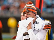 CHARLOTTE, NC - DECEMBER 21:  Johnny Manziel #2 of the Cleveland Browns watches from the bench during the second half of a loss to the Carolina Panthers at Bank of America Stadium on December 21, 2014 in Charlotte, North Carolina.  (Photo by Grant Halverson/Getty Images)