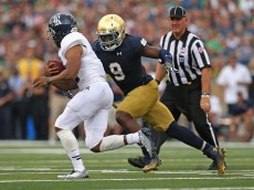 SOUTH BEND, IN - AUGUST 30:  Jaylon Smith #9 of the Notre Dame Fighting Irish moves to tackle Darik Dillard #32 of the Rice Owls at Notre Dame Stadium on August 30, 2014 in South Bend, Indiana. Notre Dame defeated Rice 48-17.  (Photo by Jonathan Daniel/Getty Images)