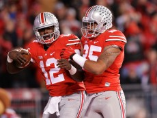 COLUMBUS, OH - NOVEMBER 7:  Cardale Jones #12 of the Ohio State Buckeyes celebrates his fourth quarter touchdown run against the Minnesota Golden Gophers with teammate Marcus Baugh #85 of the Ohio State Buckeyes at Ohio Stadium on November 7, 2015 in Columbus, Ohio. Ohio State defeated Minnesota 28-14.  (Photo by Jamie Sabau/Getty Images)