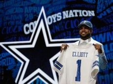 CHICAGO, IL - APRIL 28:  Ezekiel Elliott of Ohio State holds up a jersey after being picked #4 overall by the Dallas Cowboys during the first round of the 2016 NFL Draft at the Auditorium Theatre of Roosevelt University on April 28, 2016 in Chicago, Illinois.  (Photo by Jon Durr/Getty Images)