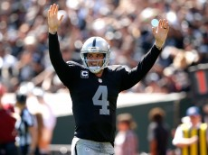 OAKLAND, CA - SEPTEMBER 20:  Derek Carr #4 of the Oakland Raiders celebrates a touchdown in the second quarter against the Baltimore Ravens at Oakland-Alameda County Coliseum on September 20, 2015 in Oakland, California.  (Photo by Ezra Shaw/Getty Images)