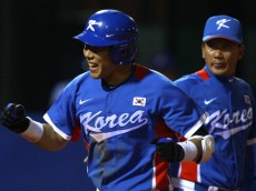 GUANGZHOU, CHINA - NOVEMBER 19:  Jungho Kang #16 of South Korea reacts after he hits a third inning home run while taking on Chinese Taipei during the gold medal baseball game at Aoti Baseball Field 1 during day seven of the 16th Asian Games Guangzhou 2010 on November 19, 2010 in Guangzhou, China.  (Photo by Richard Heathcote/Getty Images)