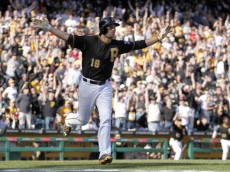 PITTSBURGH, PA - MARCH 31:  Neil Walker #18 of the Pittsburgh Pirates celebrates after hitting a walk off solo home run in the tenth inning against the Chicago Cubs during Opening Day at PNC Park March 31, 2014 in Pittsburgh, Pennsylvania.  (Photo by Justin K. Aller/Getty Images)