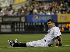 NEW YORK, NY - APRIL 13:  Francisco Cervelli #29 of the New York Yankees sits on the field after injuring himself running to first base against the Boston Red Sox  at Yankee Stadium on April 13, 2014 in the Bronx Borough of New York City.  (Photo by Jeff Zelevansky/Getty Images)