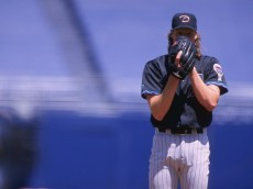 25 Apr 1999:  Pitcher Randy Johnson #51 of the Arizona Diamondbacks gets ready to pitch the ball during the game against the San Diego Padres at Qualcomm Stadium in San Diego, California. The Diamondbacks defeated the Padres 5-3. Mandatory Credit: Todd Warshaw  /Allsport