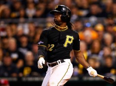 PITTSBURGH, PA - OCTOBER 01:  Andrew McCutchen #22 of the Pittsburgh Pirates hits a single in the sixth inning against the Cincinnati Reds during the National League Wild Card game at PNC Park on October 1, 2013 in Pittsburgh, Pennsylvania.  (Photo by Jared Wickerham/Getty Images)