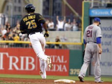 PITTSBURGH, PA - JUNE 26:  Gregory Polanco #25 of the Pittsburgh Pirates rounds first after hitting a three run home run in the fifth inning against the New York Mets during the game at PNC Park on June 26, 2014 in Pittsburgh, Pennsylvania.  (Photo by Justin K. Aller/Getty Images)