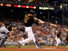 PITTSBURGH, PA - AUGUST 12:  Jordy Mercer #10 of the Pittsburgh Pirates hits a RBI single in the third inning against the Detroit Tigers during inter-league play at PNC Park on August 12, 2014 in Pittsburgh, Pennsylvania.  (Photo by Justin K. Aller/Getty Images)