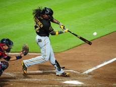 ATLANTA, GA - SEPTEMBER 22: Andrew McCutchen #22 of the Pittsburgh Pirates hits a sixth inning solo home run against the Atlanta Braves at Turner Field on September 22, 2014 in Atlanta, Georgia. (Photo by Scott Cunningham/Getty Images)