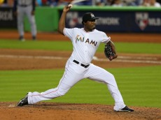 MIAMI, FL - SEPTEMBER 12: Arquimedes Caminero #49 of the Miami Marlins pitches during a game against the Atlanta Braves at Marlins Park on September 12, 2013 in Miami, Florida.  (Photo by Mike Ehrmann/Getty Images)
