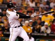 PITTSBURGH, PA - SEPTEMBER 18:  Chris Stewart #19 of the Pittsburgh Pirates hits a RBI single in the fourth inning against the Boston Red Sox during inter-league play at PNC Park on September 18, 2014 in Pittsburgh, Pennsylvania.  (Photo by Justin K. Aller/Getty Images)