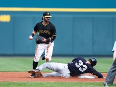 BRADENTON, FL - MARCH 5: Garrett Jones #33 of the New York Yankees breaks up a double play attempt against Sean Rodriguez #3 of the Pittsburgh Pirates during the game at McKechnie Field on March 5, 2015 in Bradenton, Florida. (Photo by Joe Robbins/Getty Images)