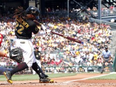 PITTSBURGH, PA - JULY 05:  Andrew McCutchen #22 of the Pittsburgh Pirates hits a two run home run in the first inning against the Philadelphia Phillies during the game at PNC Park on July 5, 2014 in Pittsburgh, Pennsylvania.  (Photo by Justin K. Aller/Getty Images)